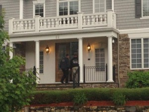 Police entering Hernandez's house