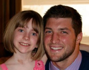 Presli Collins with Tim Tebow Photo from Tim Tebow Foundation