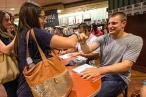 Rob Gronkowski interacts with fans at his book signing. (Photo from Boston Globe)