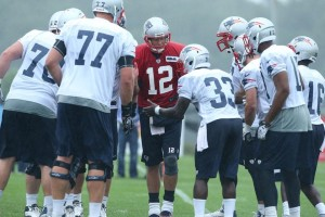 Brady commands the huddle Photo by David Silverman