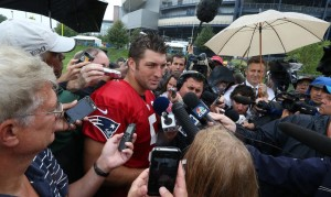 Tebow talks to the media Photo by Photo by David Silverman (Patriots.com)
