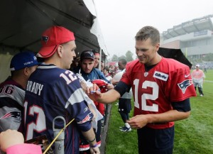 Brady signing autographs Photo by AP Photo