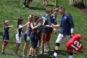 Brady high fives his fans Photo by David Silverman
