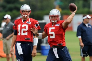 Brady and Tebow  Photo by Keith Nordstrom