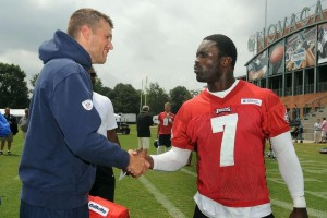 Tom Brady and Michael Vick  Photo by Keith Nordstrom