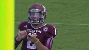 Johnny Manziel during the game vs Rice. Fake signing Autographs