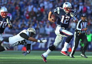 Tom Brady runs for first down Photo by: David Silverman