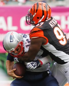 QB Tom Brady getting sacked by Geno Atkins Photo by AP