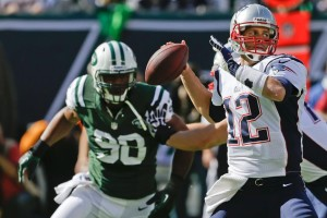 Tom Brady passing Photo by: Seth Wenig