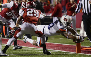 Tre Mason rushed for 168 yards and four touchdowns against Arkansas in 2013.  Photo By: Todd Van Emst/Auburn University)
