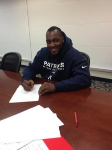 Zach Moore signing his contract with the New England Patriots Photo By: Blake Baratz, Moore's agent. via Twitter