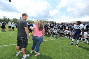 Danny Nickerson, a shy boy, being sung Happy Birthday to by the Patriots.  (Photo From Patriots.com)