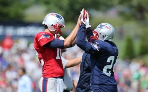 Tom Brady and Darrelle Revis high fives during practice. (Photo From Patriots.com)