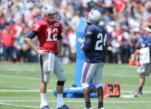 Tom Brady chatting with Darrelle Revis at practice.  (Photo By David Silverman)