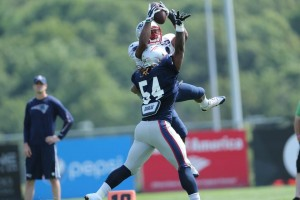 Shane Verren jumps up over Hightower for a catch. (Photo By David Silverman)