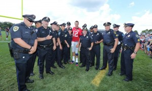 Tom Brady takes a picture with State Troopers (Photo By Daivd Silverman)