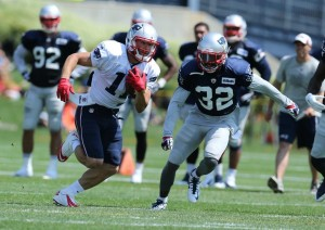 Julian Edelman makes a catch in training camp today. (Photo By David Silverman)