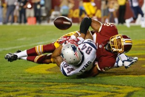 Brian Tymes makes a circus catch that ruled hit the ground. It didn't though. (Photo From Patriots.com)