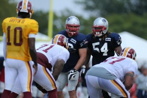 Rob Ninovich and Dont'a Hightower talk defense against RG3 and the Redskins (Photo By David Silverman)