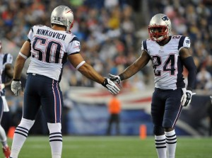 Darrelle Revis and Rob Ninkovich celebrate a good play. (Photo By Keith Nordstrom)