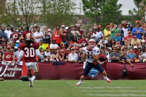 Julian Edelman makes a catch during Training Camp. (Photo By Keith Nordstrom)