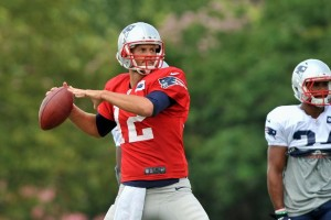 Tom Brady drops back for a pass (Photo By Keith Nordstrom)