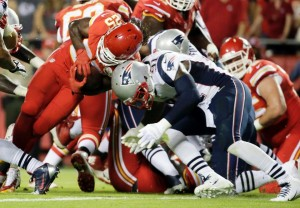 Jamie Collins tackles Jamaal Charles  (Photo From Patriots.com)