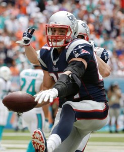 Gronk Spikes after he scores his first touchdown of the 2014 season. (Photo From AP)