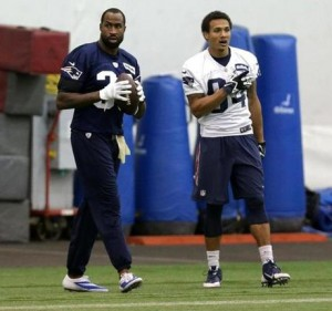 Brandon Browner (left) and Brian Tyms (Right) ready to play. (Photo By: BARRY CHIN/GLOBE STAFF)