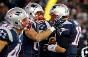 Tom Brady and Rob Gronkowski celebrate during the Broncos game. (Photo By: Photo by Jim Rogash/Getty Images)
