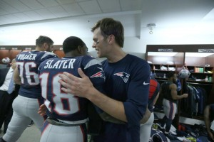 Tom Brady celebrates with teammate Matthew Slater after beating the Lions. (Photo By: David Silverman)