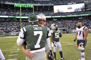 Tom Brady and Geno Smith show sportsmanship. (Photo By: Keith Nordstrom)