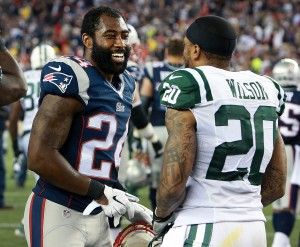 Revis wore the Red. White, and Blue for one season, will return to Green and White in 2015. (Globe Staff Photo/Jim Davis)