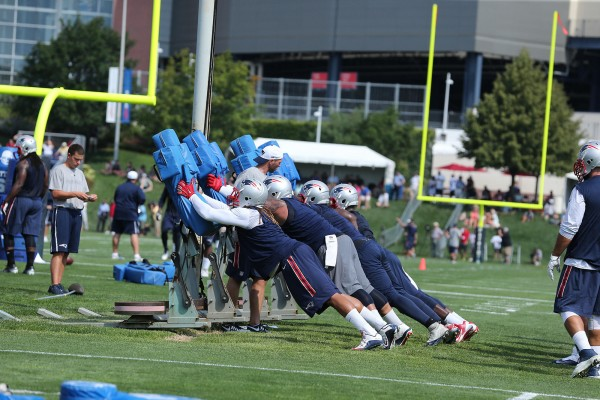 Defensive players going through drills. (Photo By: David Silverman)