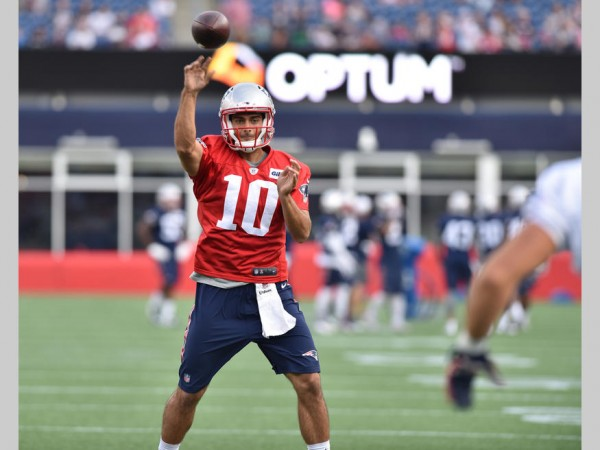 Jimmy Garoppolo throws a pass during warm ups. (Photo By: Keith Nordstrom)