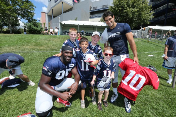 DE Chandler Jones and QB Jimmy Garoppolo with fans. (Photo By: David Silverman)