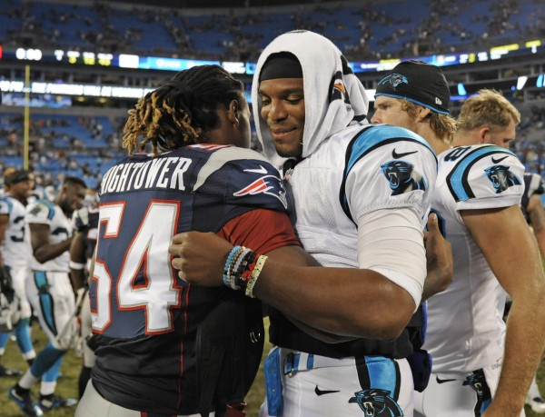 Former college rivals, Hightower (Alabama) and Cam Newton (Auburn) hug after the game last night. (AP Photo/Mike McCarn)
