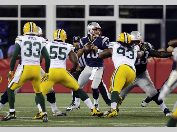 New England Patriots quarterback Jimmy Garoppolo (10) looks for a receiver against the Green Bay Packers during the first half of an NFL preseason football game Thursday, Aug. 13, 2015, in Foxborough, Mass. (AP Photo/Charles Krupa)