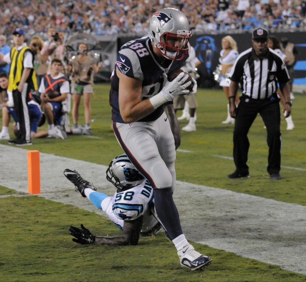 Scott Chandler catches a touchdown pass against the Panthers before the half. (AP Photo/Mike McCarn)
