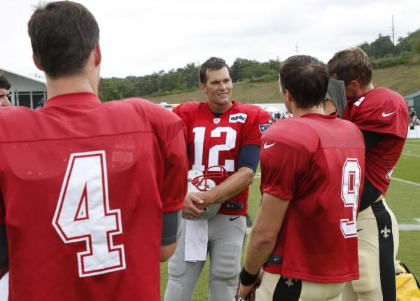 Brady chats with all three of the Saints QB. (Photo By: AP/Steve Helber)
