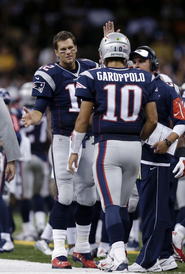 Tom Brady shows support for Jimmy Garoppolo. (Photo By: Brynn Anderson)