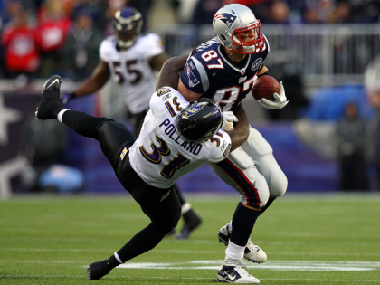 FOXBORO, MA - JANUARY 22:  Rob Gronkowski #87 of the New England Patriots gets tackle by Bernard Pollard #31 of the Baltimore Ravens during their AFC Championship Game at Gillette Stadium on January 22, 2012 in Foxboro, Massachusetts.  (Photo by Al Bello/Getty Images)