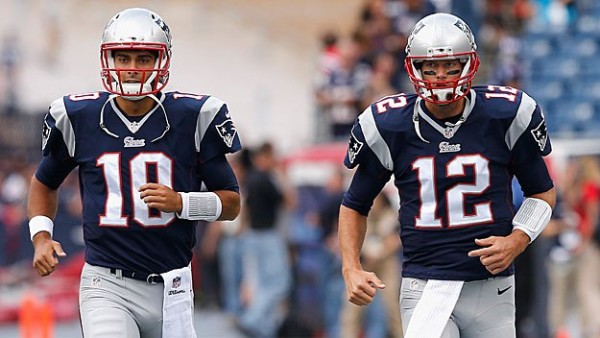 Jimmy Garoppolo and Tom Brady during the 2014 season game against the Bills. (Photo by Jim Rogash/Getty Images)