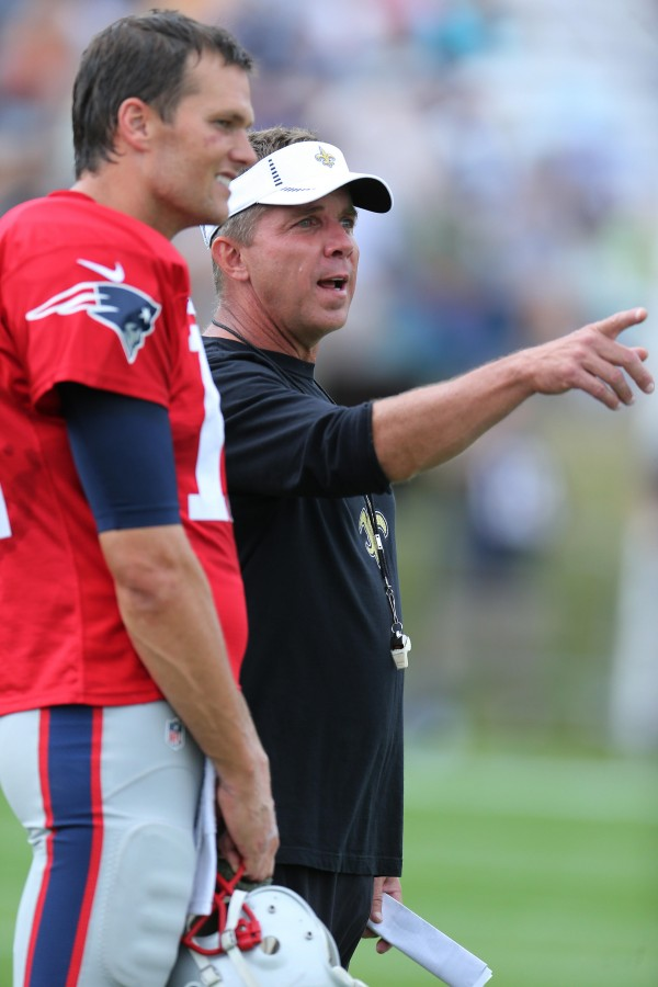 Brady and Saints coach Sean Payton chat. (Photo By: David Silverman)