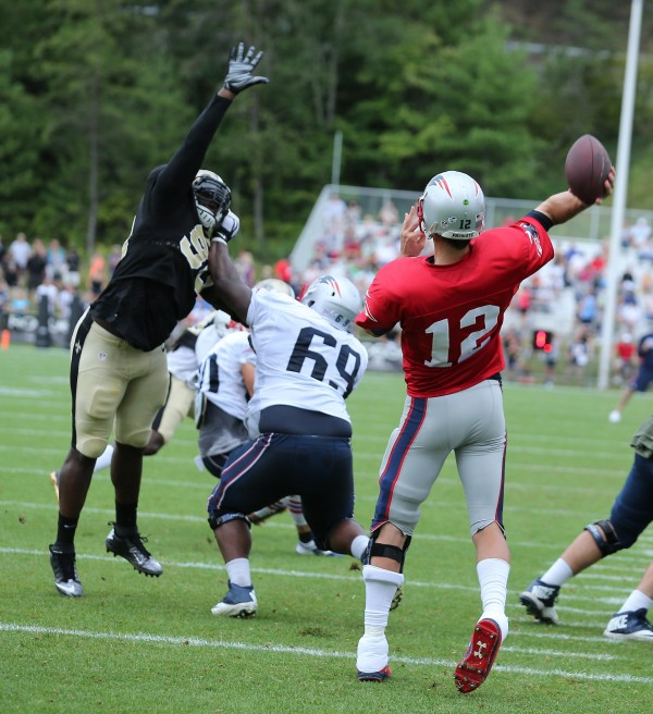 Tom Brady throws a strike against the Saints defense. (Photo By: David Silverman)