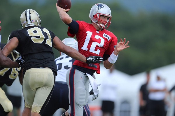 Brady delivers a pass under pressure. The 3x SB MVP was sacked twice today. (Photo By: David Silverman)