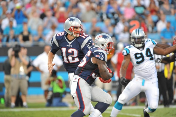 Tom Brady hands off to Jonas Gray. (Photo By: Keith Nordstrom)