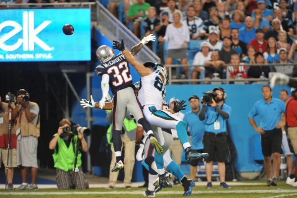 FS Devin McCourty back at his safety spot, makes the play. (Photo By: Keith Nordstrom)