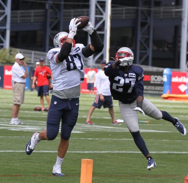 Gronk makes the catch over safety Tavon Wilson. (Photo By: Eric Adler)