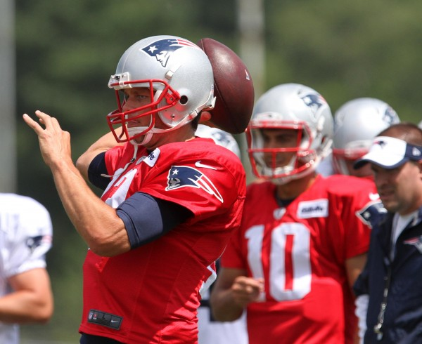 QB Tom Brady passes during camp. (Photo By: Eric Adler)